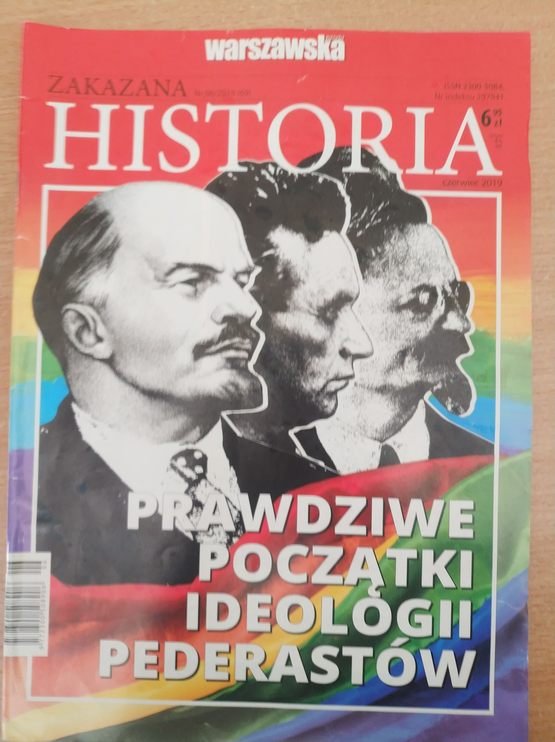 """A newspaper with Lenin, Trotsky and some other old guy in front of a rainbow flag titled """"the true origins of the pederast ideology"""""""