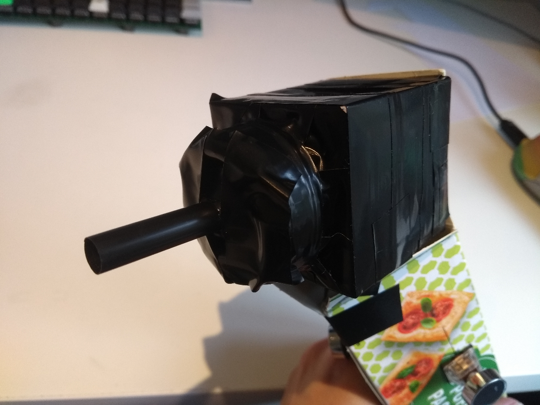 The black box - there's a straw coming out of it to use as a mouthpiece