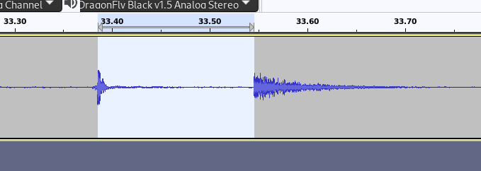 Audacity screenshot showing sound of key going down at 33.386 seconds and sound coming out of speakers at 33.546 seconds