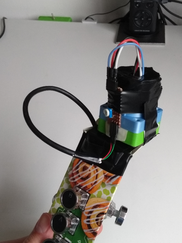 The other side of the mouthpiece, with a small board for adjusting the internal LED and connected via a cut up USB cable